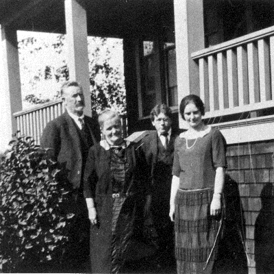 The Baillie family standing in front of their house on Laity Street.  Left to right - John, Mary, George and Eunice Baillie.
