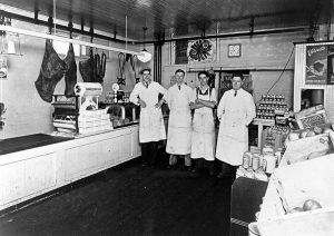 Interior of Clappison Bros Butcher Shop in 1931-32.  Left to Right is Ernie Zeron, John Clappison, Jack Reid, and William Clappison.