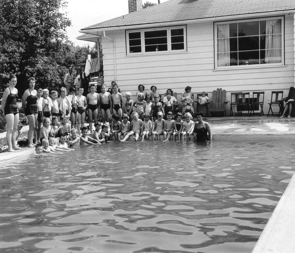 Swimming lessons at the MacKenzie pool before the city's pool was built.  Nora MacKenzie proudly gave lessons in the Fraser River, and then, once she and her husband had built a backyard pool in 1956, at home in Haney.
