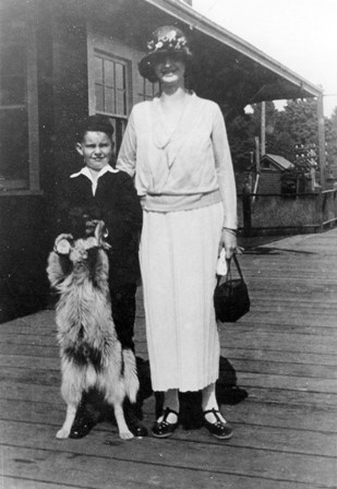 Hyacinth and Norm Pelkey with their dog on the platform of the Ruskin Station circa 1921.