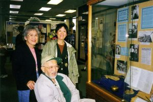 Norm (Taka) Tsuyuki, his wife Irene, and daughter visiting the Maple Ridge Museum display at the library just prior to his death in 1998.