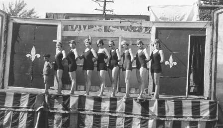 Adella and the Diving Venuses, circa 1919,  lined up in front of their diving tank on stage in the Seattle area.