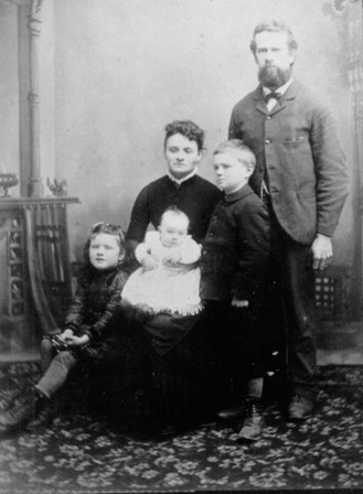 Hector and Mary Lavinia Ferguson with three of their six children in 1890.  From left to right, children are Mary, Hector and Archibald.