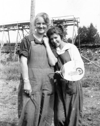 Mildred Gilchrist [at right, daughter of George Gilchrist] and her good friend Violet Knowles on the Gilchrist farm (Kildonan) in Ruskin.  Knowles summered there from Vancouver.  The structure behind the women is interesting but unidentified.  1923 c