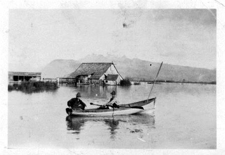 Pitt Meadows 1928 flooding.  David Blaney (Passenger), Jack Sharpe (rowing) in the area north of Harris Road & Katzie Slough.