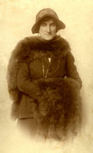 Alice Marc with a fur stole and muff.  She looks to be about 40 [1927c].