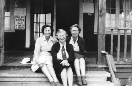Three equestrian women sitting on front porch of what is most likely the Hitching post at 232 Street and Fern Crescent in the 1950's. From left: Mrs. C R Hirshfield, Margaret Trethewey, and Molly Buckerfield.