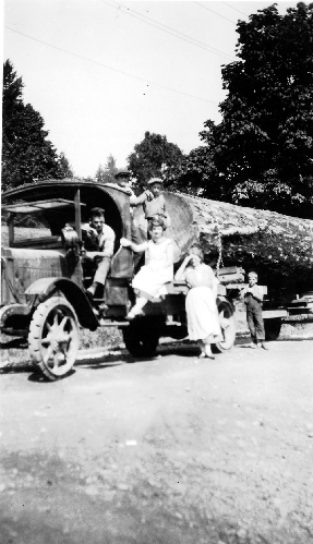 """Day-Elder"" logging truck on River Road in Whonnock in 1924-25.  The two women (left to right) are Beatrice and Edith Luno."