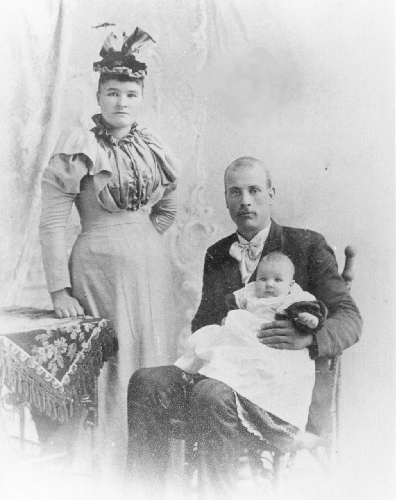 Robert Robertson seated with his child and wife in the 1910's.