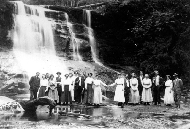 A young adults group visits Cliff Falls on Kanaka Creek in 1910.