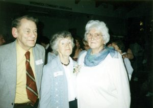 Brian and Isabel Byrnes standing with Mrs. Cummings in the Whonnock Hall in the 1980's.