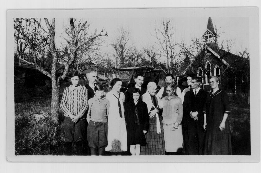 Members of the Graham and Drewry families taken Christmas Day 1928 in front of Whonnock Anglican Church.