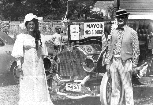 Mayor Betty Dube with the owner of a 1908 Canadian made automobile judged best vintage car in the 1974 Fall Fair parade.