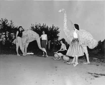 Fall Fair Queen Contestants play in Dyck's Dinosaur park, 1950's.